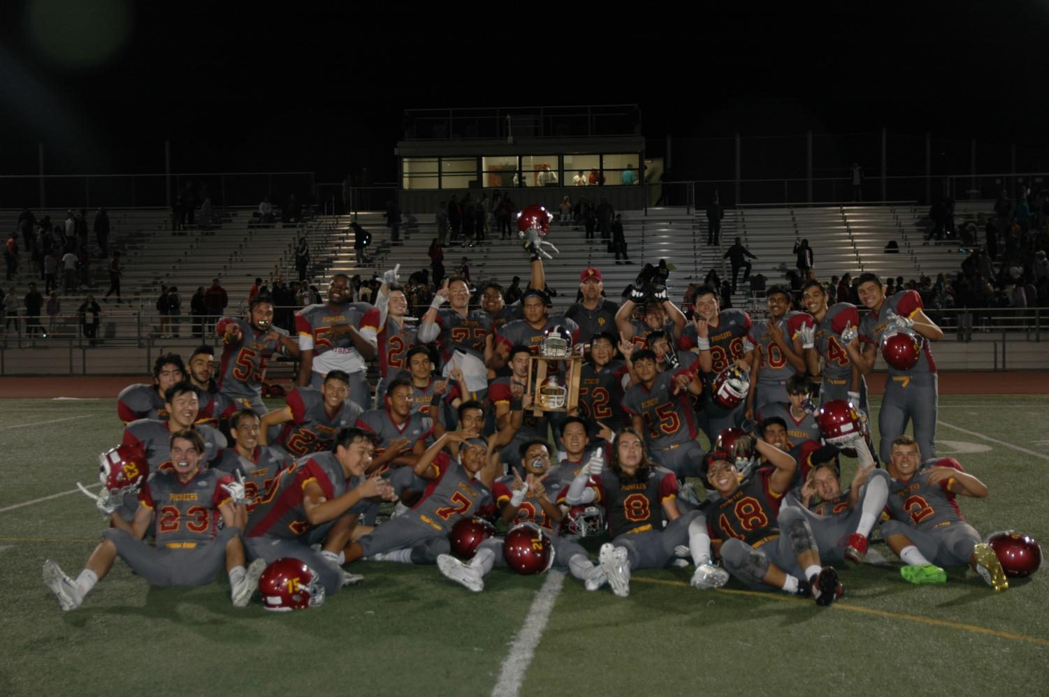 The varsity football team celebrates their third consecutive victory against Monta Vista in the annual Helmet Game.